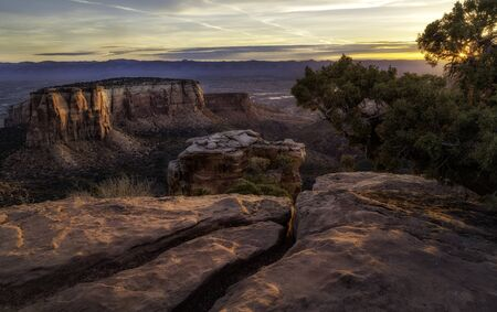 Rock formations flow in the morning sunlight along the overlook at Colorado National Monument located in Grand Junction, Colorado Stock Photo