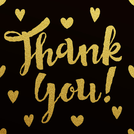 hand with card: Thank You card with design of gold letters on black background
