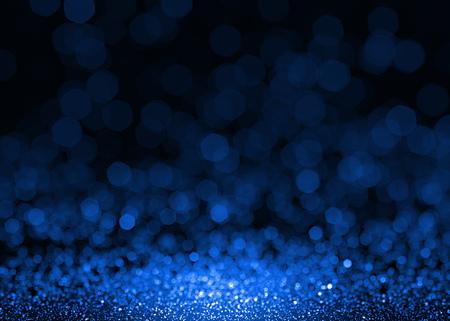 抽象的な青い輝きキラキラ背景。