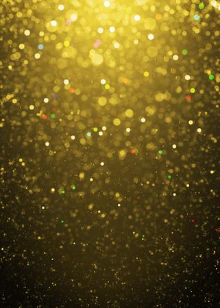 bokeh lights: Defocused gold sparkle glitter lights background. Highlighted glitter bokeh background