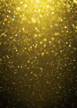 art effect: Defocused gold sparkle glitter lights background. Highlighted glitter bokeh background