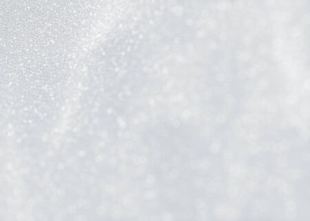 ice surface: Glittering winter background. White sparkling texture with snowflakes.