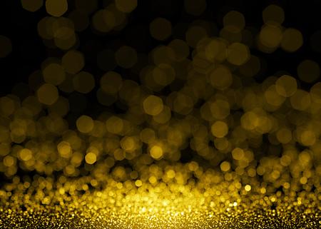 ゴールドに輝いてキラキラ ライト背景をデフォーカス。キラキラ背景のボケ味
