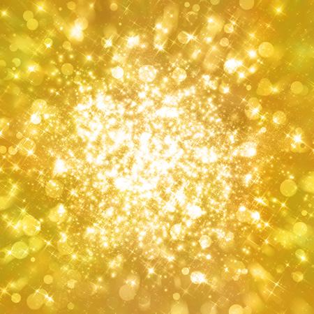 金色のきらびやかな背景に星がきらきら輝く。抽象的なゴールドのきらめきを背景。