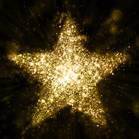night party: Gold glitter star of defocised blinking stars Stock Photo