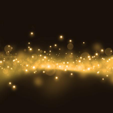Gold glittering stars dust trail on dark background
