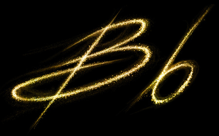 b and w: B letter of gold glittering stars dust flourish tail. Glittering font concept