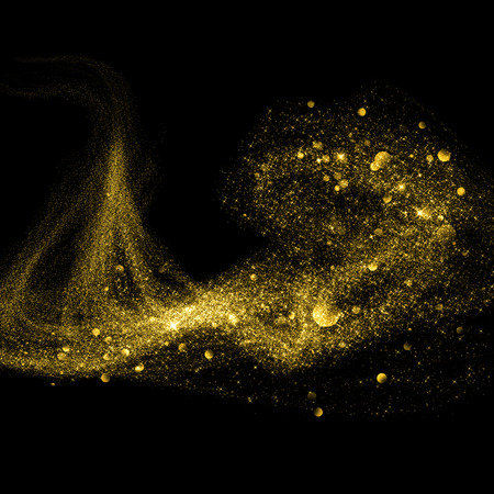 bling bling: Gold glittering stars dust trail on black background Stock Photo
