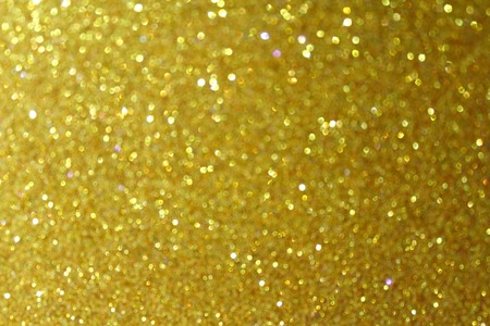 gold textured background: Gold glitter particles textured background