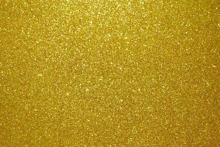 Het goud schittert deeltjes geweven achtergrond