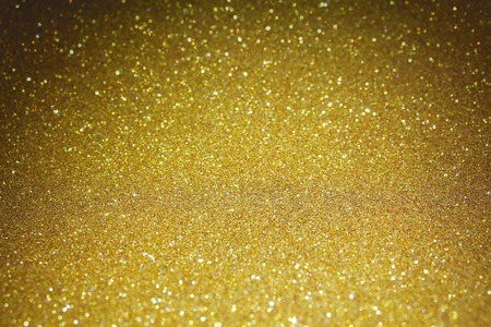 metal background: Gold glitter particles textured background