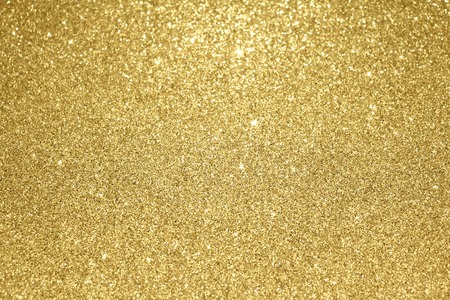 Gold glitter particles textured background