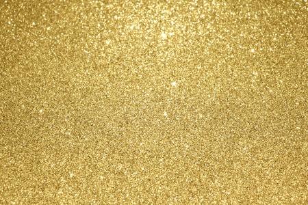 oro: Fondo partículas brillo del oro con textura Foto de archivo