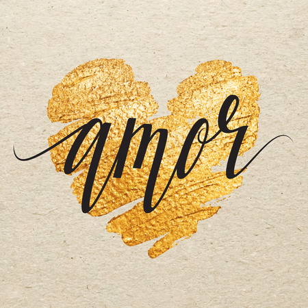 amor: Spanish Valentines day card. Amor calligraphy lettering with gold paint heart on craft background. Hand drawn letters.