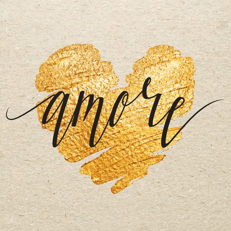 amore: Italian Valentines day card. Amore calligraphy lettering with gold paint heart on craft background. Hand drawn letters.