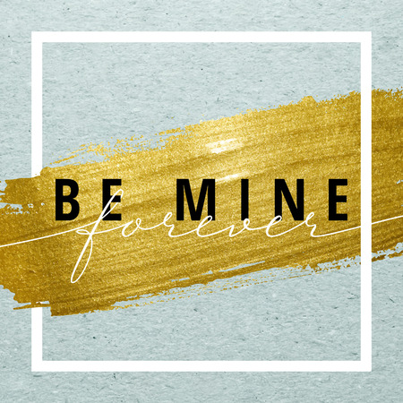 gold banner: Be mine forever for Valentines day card. Calligraphy lettering on gold paint stroke with frame on craft background. Love design concept.