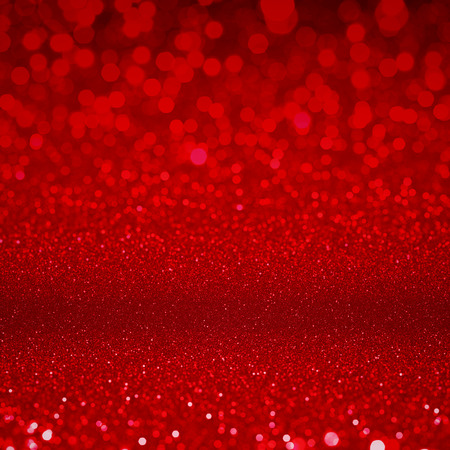ruby red: Red glitter sparkles. Textured christmas sequins background. Fashion glamour ruby glittering wallpaper
