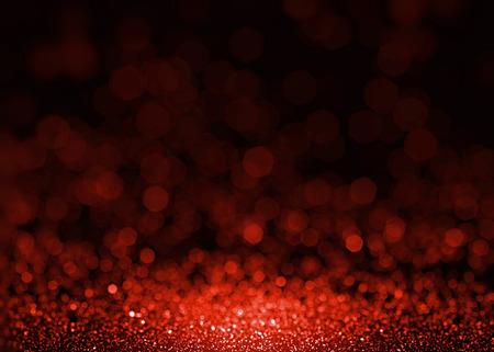 赤の美しいキラキラの輝き。ファッション魅力スパンコール背景にテクスチャ。クリスマスのきらびやかな壁紙。スプラッタを輝くルビーの宝石。 写真素材