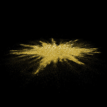 powder: Gold glitter powder scattered on black background. Golden color dust splash on black horisontal surface. Flour specks with gold texture for fashion background, luxury. Magic mist glowing
