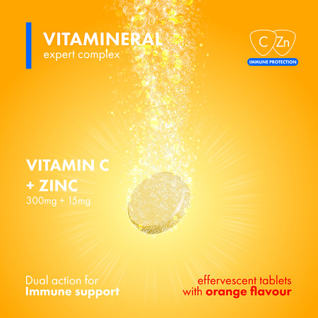 Effervescent soluble tablet pills. Vitamin C plus Zink soluble pills with orange flavour in water with sparkling fizzy bubbles trail. Vitamineral complex pacakge design with citrus yellow background