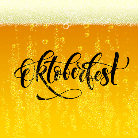 foam party: Oktoberfest lettering for famous beer festival in Germany on beer background with sparkling beer foam and bubbles