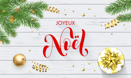 Joyeux Noel French Merry Christmas holiday golden decoration and calligraphy font for greeting card white wooden background. Vector Christmas or New Year golden shiny gift for Xmas decoration design