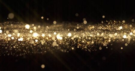 Gold glitter particles, light bokeh wave and golden shimmering sparkles overlay effect. Gold shimmer glow glittering sparkles shine, abstract magic snow bright light blur wave Zdjęcie Seryjne