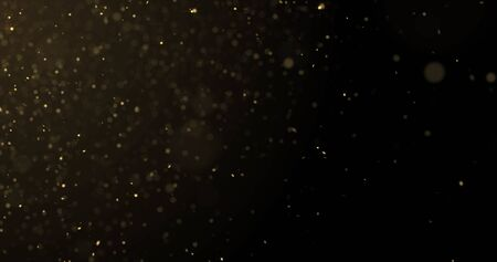 Golden glitter rain, gold particles splash on luxury black and gold background. Bokeh light and golden sparks shimmer glow flow Zdjęcie Seryjne - 131943921