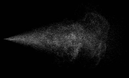 Spraying mist effect of air gun sprayer droplets jet isolated on black