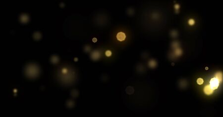Bokeh light gold shine background with abstract blur flare effects. Golden yellow glitter particle flares with bright glowing shiny light bokeh sparkles on black background