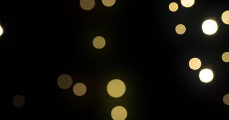 Bokeh light background, gold shine abstract particles with blur flare effect. Golden glitter glowing shiny bokeh light sparkles on black background