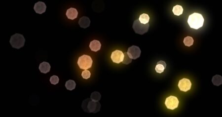 Bokeh light gold shine glares and particles glitter background. Abstract golden bokeh light sparkles, glowing shiny defocused light blur spots on black background