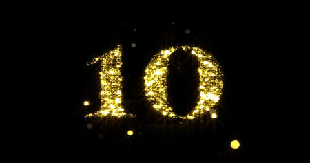 Number ten glitter gold. Golden glittering number 10 with glister light and shiny sparks on black background 版權商用圖片