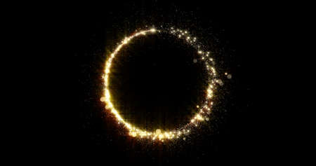 Gold glitter circle trail with glittering glister. Shiny golden glittering ring with light sparks and particles trace, glisten bokeh sparks and shimmer swirl black background 版權商用圖片