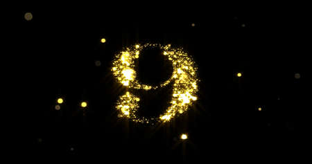 Number nine glitter gold. Golden glittering number 9 with glister light and shiny sparks on black background 版權商用圖片