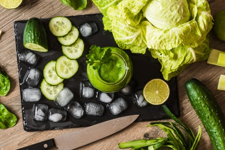 spinage: Detox diet. Green smoothie with different vegetables on wooden background Stock Photo