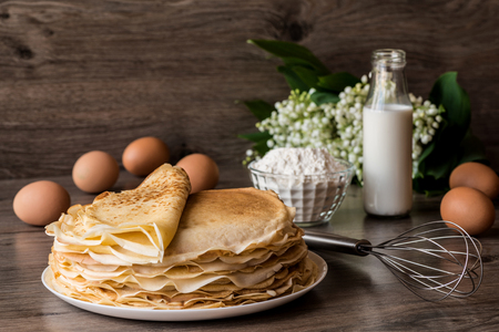 Delicious pancakes on wooden table Stock Photo