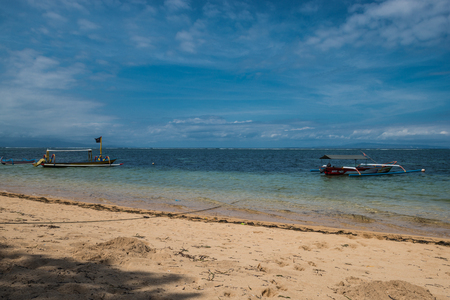 revulsion: Traditional balinese dragonfly boat on the beach. Jukung fishing boats on Sanur beach, Bali, Indonesia, Asia