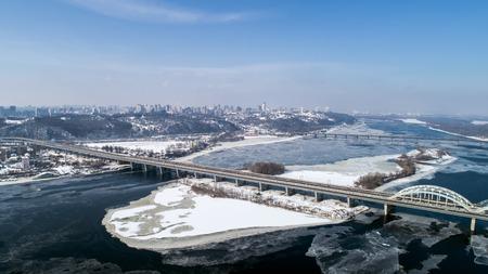 Aerial view of the Kiev city, Ukraine. Dnieper river with bridges. Darnitskiy bridge Reklamní fotografie