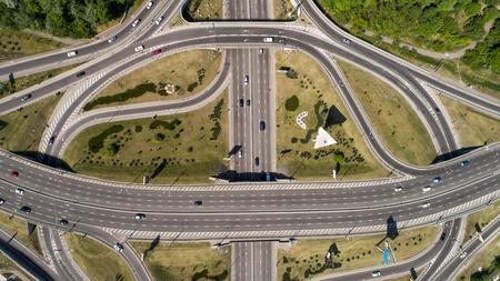Aerial view of a turbine road interchange in Kiev. Cityscape in summer 免版税图像
