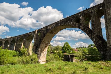Old railway bridge, old viaduct Vorohta, Ukraine. Carpathian Mountains, wild mountain landscape Archivio Fotografico