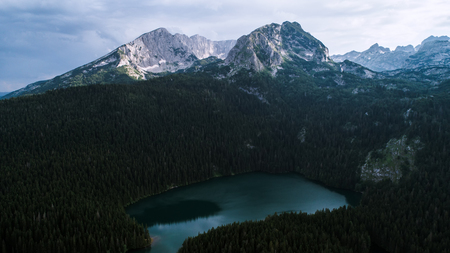 Aerial view at a beautiful lake in the mountains. Black Lake, Montenegro.