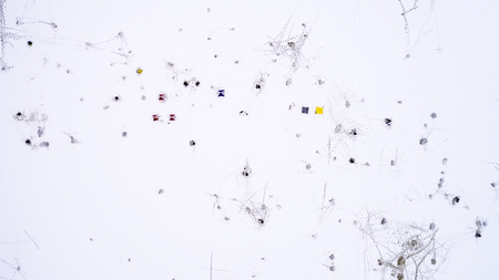 Aerial view of winter fishing. Fishermen set up tents for fishing at night.