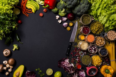 Trend set of fresh vegetables and fruits on black background. Different colorful fresh vegan food. Flat lay. Space for text.