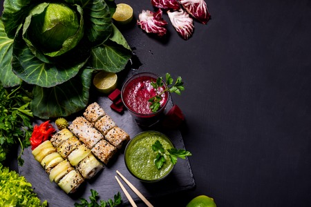 Japanese food. Healthy vegan drinks with fruits and vegetables on the black background. Flat lay
