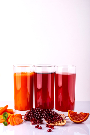 Set of healthy fresh drinks on the white background. Raw drinks and foods. Reklamní fotografie
