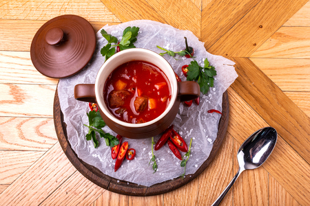 Tasty Hungarian Hot Goulash Soup Bograch or Gulas Lamb Meat Stew on Wooden Surface at Restaurant. Traditional Food.