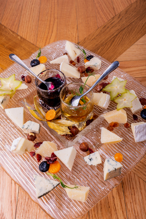 Cheese plate. Top view. Tasty cheese starter.