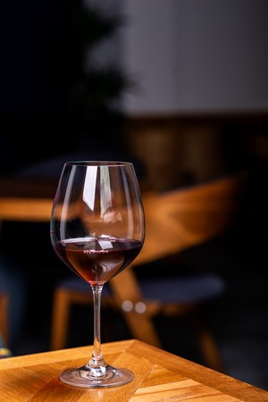 Glass with red wine, tasting, restaurant Imagens