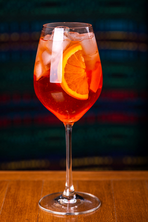 Aperol spritz cocktail in glass on wooden table in the interior of the restaurant. Stock Photo